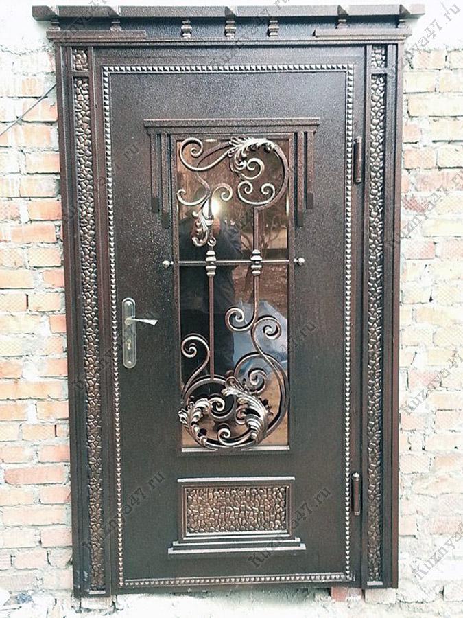 железная кованая входная дверь фото деталь рисунке
